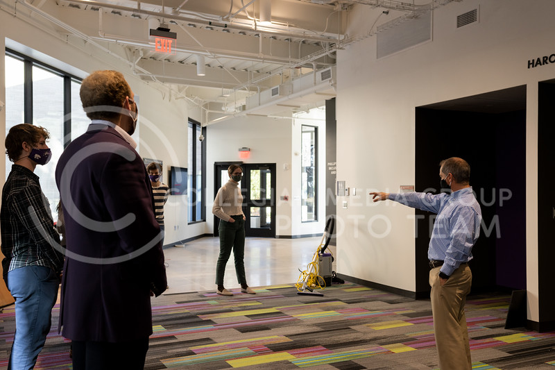 Adrian Rodriguez, associate vice president for student life of diversity and multicultural student affairs, leads a tour to the K-State SGA, of the K-State Multicultural Student Center on Nov 18, 2020. (Dylan Connell | Collegian Media Group)