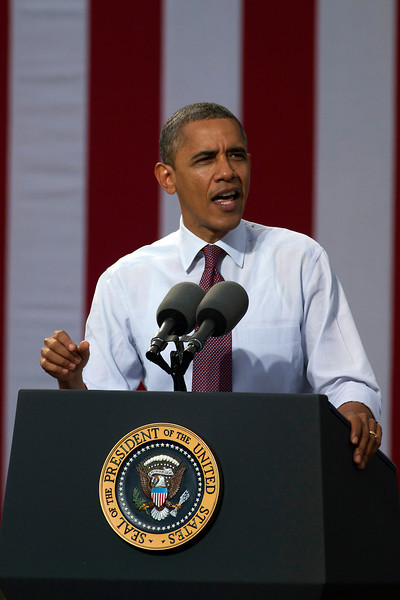 """October 27, 2012 -- President Barack Obama speaks at Elm Street Middle School in Nashua, New Hampshire during the """"Around the Clock for Barack: the 24 Hour Tour for the Middle Class"""" campaign. According to an Obama campaign source 8,500 people turned up to this event, the president's sixth appearance in the swing state in 2012, and the tenth since his presidency began."""