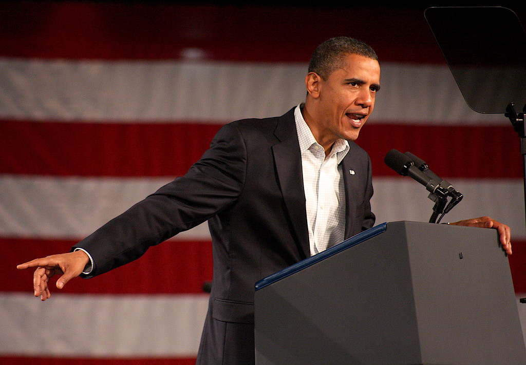 United States President Barack Obama thanks the crowd after giving a speech at a rally to re-elect Massachusetts Governor Deval Patrick on October 16, 2010 at Hynes Convention Center in Boston, Mass.