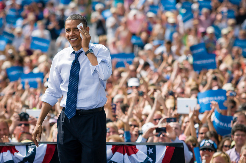 Portsmouth, NH, Sept. 7, 2012 - President Barack Obama wipes his brow after speaking to a crowd estimated at over 6,000 by the campaign during a rally at the Strawbery Banke Museum in Portsmouth NH. The president appeared with Vice President Joe Biden, First Lady Michelle Obama, Dr. Jill Biden, Senator Jeanne Shaheen, and Governor John Lynch. Photo/Christopher Weigl