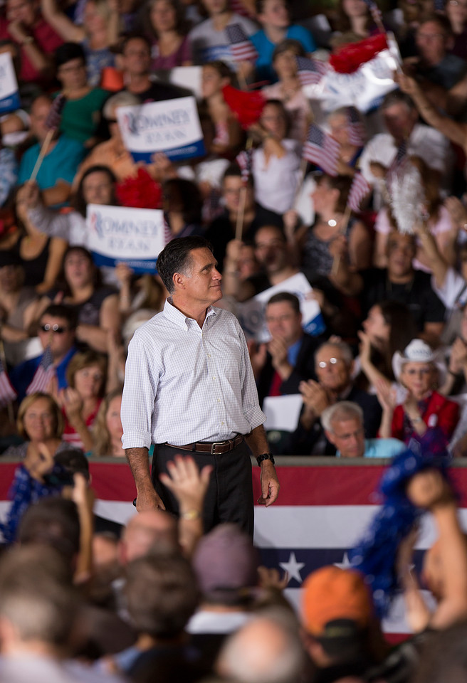 Sept. 7, 2012 - Republican presidential candidate Mitt Romney listens as supporters cheer him on during a rally in Nashua, New Hampshire. Photo by Sarah Ganzhorn.