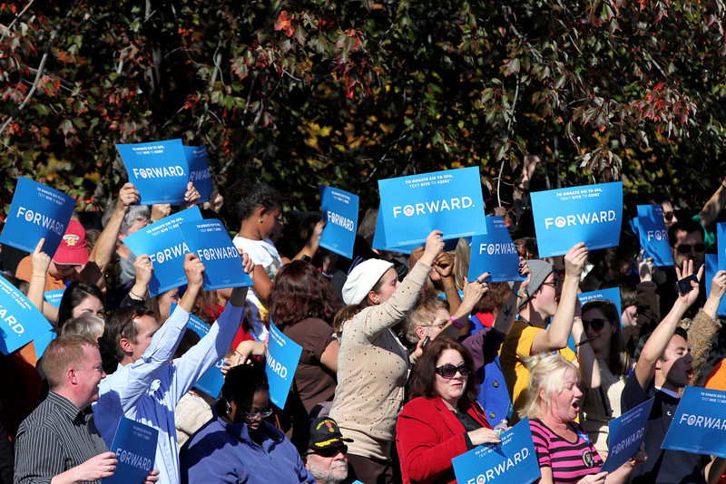 Oct. 18, 2012 - Supporters wave signs as they await the arrival of President Barack Obama at a campaign event at Veteran's Memorial Park in Manchester, New Hampshire. Photo by Billie Weiss.