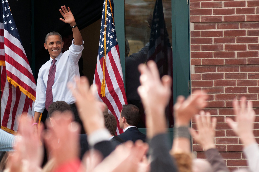 Oct. 27, 2012 - President Barack Obama waves goodbye to the crowd at a campaign rally outside Elm Street Middle School in Nashua, N.H. on Saturday. An estimated 8,500 people attended the event. Photo by Rachel Schowalter.
