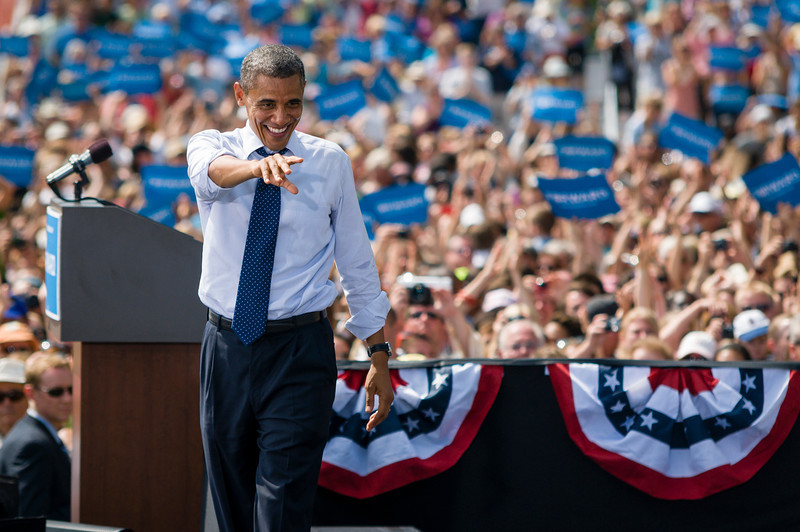 Portsmouth, NH, Sept. 7, 2012 - President Barack Obama gestures to a crowd estimated at over 6,000 by the campaign during a rally at the Strawbery Banke Museum in Portsmouth NH. The president appeared with Vice President Joe Biden, First Lady Michelle Obama, Dr. Jill Biden, Senator Jeanne Shaheen, and Governor John Lynch. Photo/Christopher Weigl