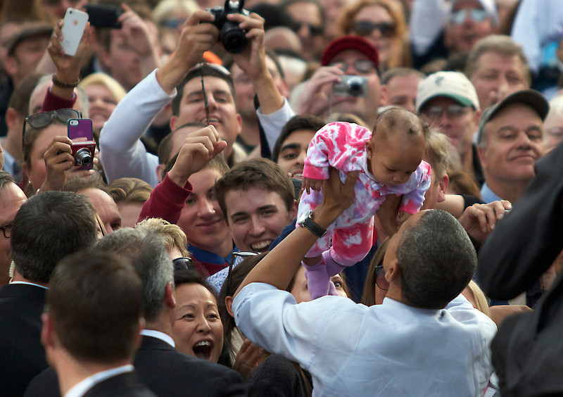 """October 27, 2012 -- President Barack Obama holds a supporter's baby following his speech at Elm Street Middle School in Nashua, New Hampshire during the """"Around the Clock for Barack: the 24 Hour Tour for the Middle Class"""" campaign.  According to an Obama campaign source 8,500 people turned up to this event, the president's sixth appearance in the swing state in 2012, and the tenth since his presidency began."""