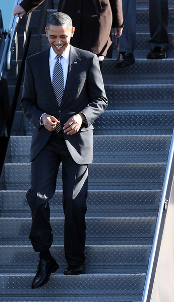 President Barack Obama exits Air Force One with philanthropist Melinda Gates on March 8, 2011 at Boston Logan International Airport enroute to a Democratic fundraiser at the Museum of Fine Arts, where he called for a renewed plan to out-educate competing countries.