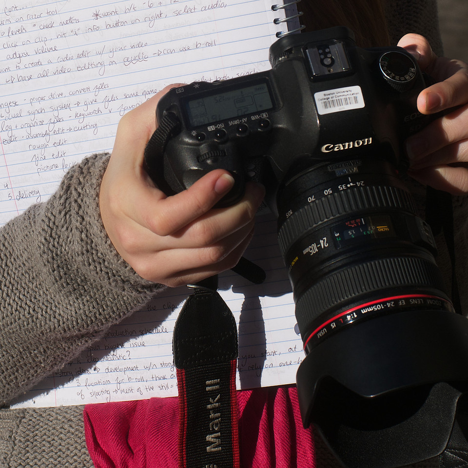 Boston, October 11, 2012: Chinatown was the classroom as photojournalism students from Boston University document the unique Boston neighborhood. They worked with stills, audio and video for a multimedia class.  Alexa Wagner, notes in hand, checks her camera settings before setting out. Photo by Peter Smith