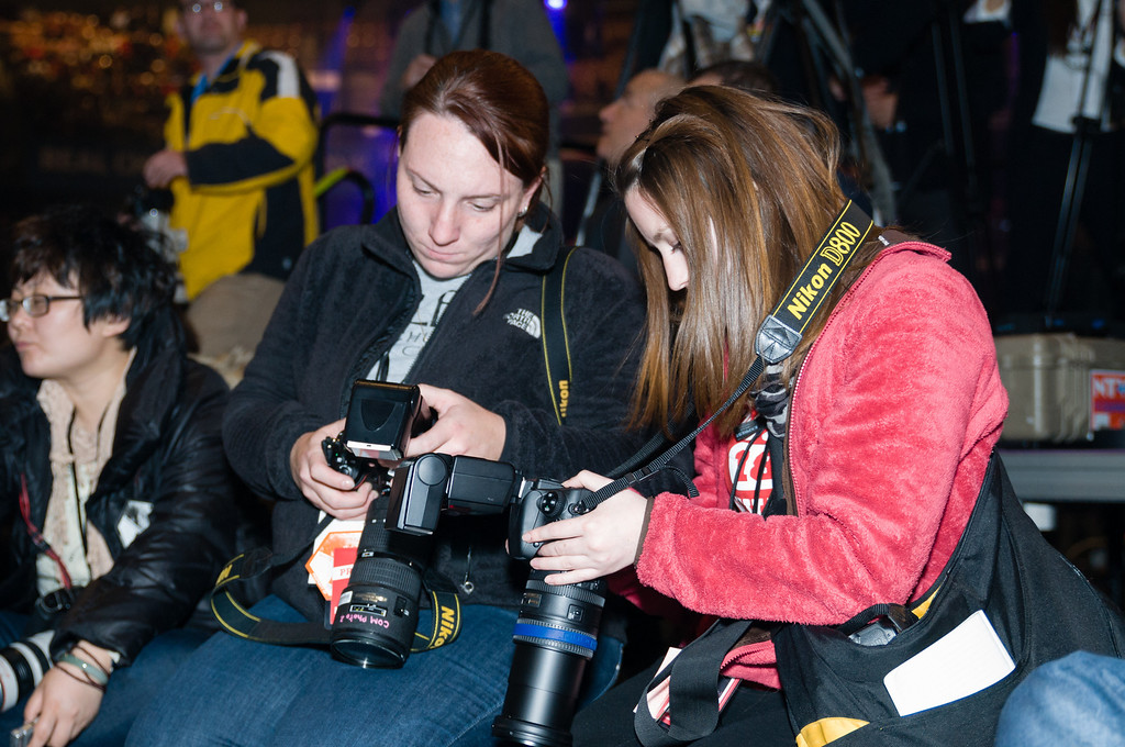 November 5, 2012 - Boston University School of Communication students Jasmin Bleu Pellegrino, left, and Cat Ring, right, check images taken during Mitt Romney's Final Election Victory Party in Manchester, NH. Romney went on to lose the election to President Obama the following day. Photo by Christopher Weigl.