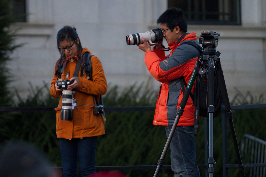 Nov. 4 - Boston University Photojournalism students Connie Liu (left) and Yuan Wang test lighting and angles before President Barak Obama's Concord, N.H. rally on Sunday.