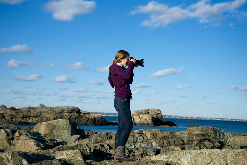 Jan. 31, 2013- Alexa Wagner scales the rocks at Forty Steps beach in Nahant, Mass., with her camera.<br /> Photo by: Jasmin Bleu Pellegrino