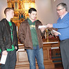 Fr. Morris of St. Mary's presents a check to Slater and Michael for their second place film.