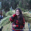Alexandra '15 carries barley that she harvested with our host family at the indigenous highland village of Huayllaccocha