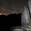 A brilliant nightscape, complete with the Milky Way and a meteor, blanket the ruins of Wiñay Wayna.