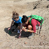 Victoria '13 and Janani '14 inspect ancient pottery at the site of San Jose de Moro