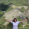 Victoria '13 triumphantly frames Machu Picchu with her arms after summiting the mountain of Wayna Picchu.