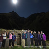 Students enjoy the nightscape at ruins along the Inca Trail.