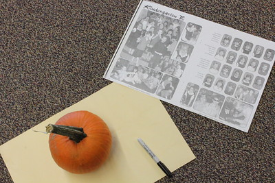 Seniors and Kindergartners carve pumpkins