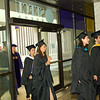 Graduate students participate in the commencement of their final year.