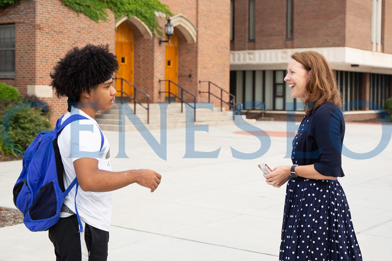 Provost Stacey Robertson greeting students on the first day of classes for Weeks of Welcome. Photo by KW