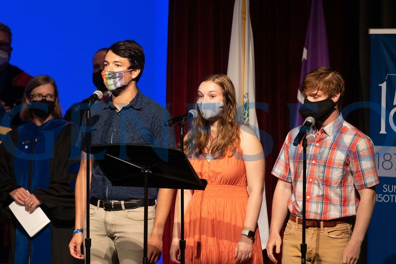 Left to right: Evan Panzer '22, Marianne Maysuch '22, Jacob Anspach '22 sing the National Anthem