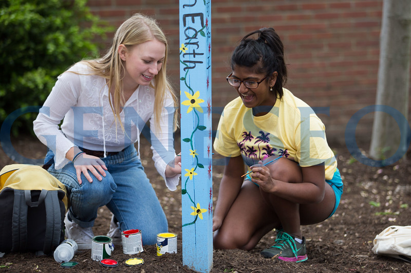 Students Painting new Peace Pole by Gazebo