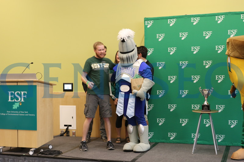 Victor E. Knight delivers the Mascot Madness Trophy to SUNY ESF / Photos by Chip Matthews