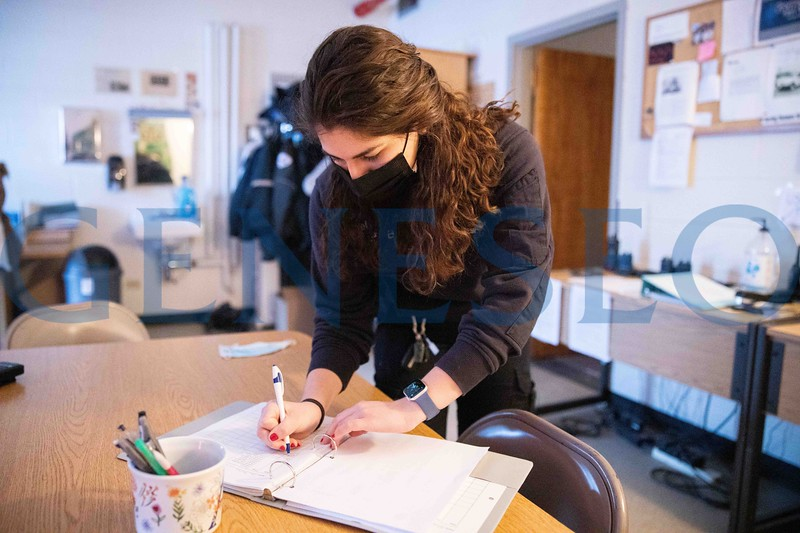 Kaylee Hausrath '21 signs off on crew members health check