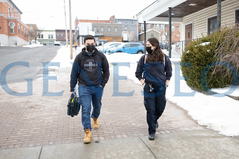 Kaylee Hausrath '21 and crewmate Matthew Desiderio '21 walk to class with their AED (Automated External Defibrillator) and medications