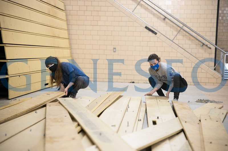 Students in the Sustainability program remove bleachers ( over 1000 ft of clear douglass fir lumber) from the old pool in Schrader to up-cycle into vertical garden shelving. Grey - Rachel Roth '21, Blue - Lauren Goulet '22, Yellow - Mailey Geiger '24