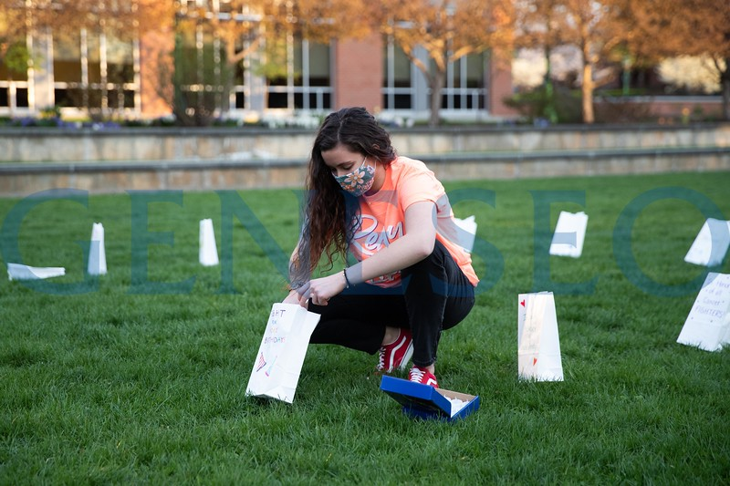 Students in the American Cancer Society on Campus at Geneseo set up luminaria bags in the shape of a ribbon on the college green in honor of people who have lost their battle, and are currently fighting cancer.