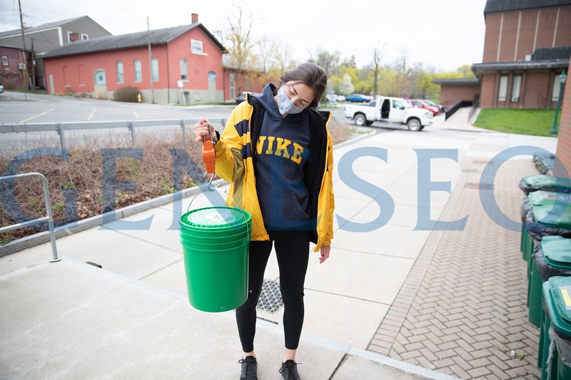 Holly Moore '23 and Yaro Bautista '23 collect, replace and clean compost buckets. Photo by Keith Walters '11