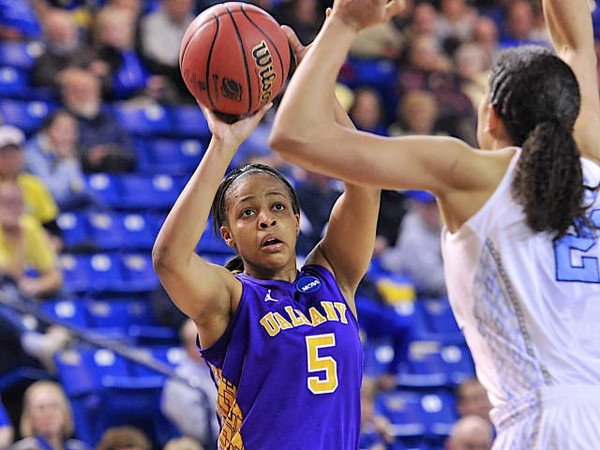 UAlbany guard/forward Ebone Henry looks for a shot as a Duke defender closes in during the 2013 NCAA Tournament.  Henry is all-time leading scorder in the program's history.<br /> Photo courtesy UAlbany Athletics
