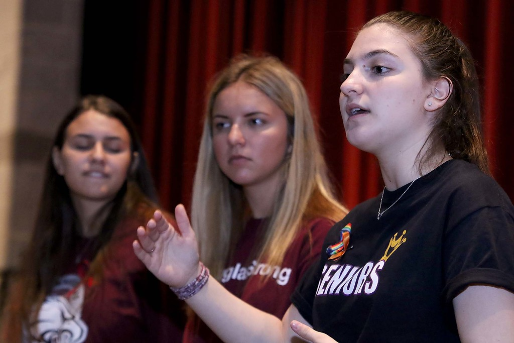 . Three students from Stoneman Douglas High School in Parkland, Florida visited Fitchburg High School to talk to a select few students about what they went through on February 14, 2018 on Wednesday morning. SDHS juniors Ma\'ayan Mizrahi and Madison Leal listen to their fellow classmate to Rebecca Schneid as she answers a question from an FHS student during their talk. SENTINEL & ENTERPRISE/JOHN LOVE