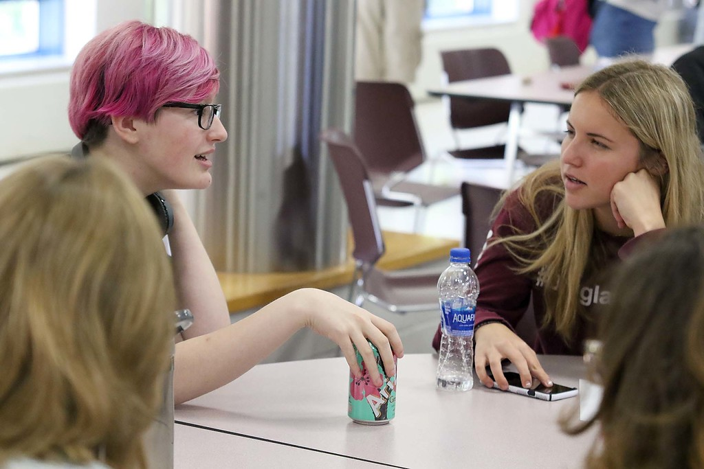 . Three students from Stoneman Douglas High School in Parkland, Florida visited Fitchburg High School to talk to a select few students about what they went through on February 14, 2018 on Wednesday morning. The SDHS students had lunch at FHS after their talk. SDHS junior Madison Leal chats with FHS junior Camryn Souza, on left, during their lunch. SENTINEL & ENTERPRISE/JOHN LOVE