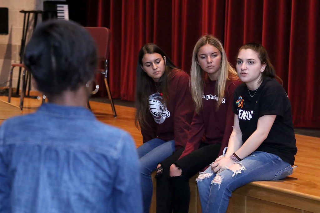 . Three students from Stoneman Douglas High School in Parkland, Florida visited Fitchburg High School to talk to a select few students about what they went through on February 14, 2018 on Wednesday morning. FHS freshman Verda Tetteh listens to, from left, Maayan Mizrahi, Madison Leal and Rebecca Schneid as they answer her question during their visit. SENTINEL & ENTERPRISE/JOHN LOVE