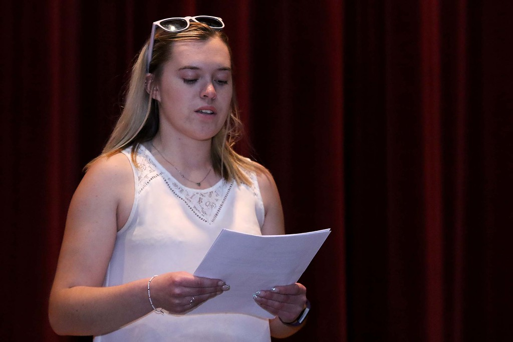 . Three students from Stoneman Douglas High School in Parkland, Florida visited Fitchburg High School to talk to a select few students about what they went through on February 14, 2018 on Wednesday morning. FHS senior Emily Hill reads a poem she wrote after the shooting at SDHS. SENTINEL & ENTERPRISE/JOHN LOVE