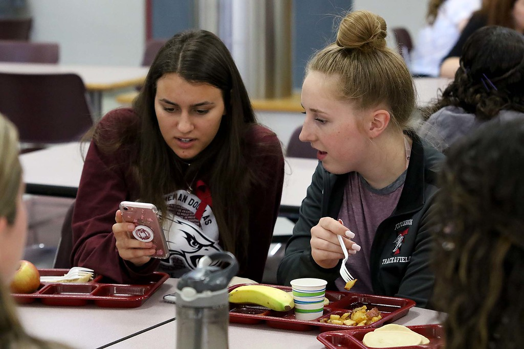 . Three students from Stoneman Douglas High School in Parkland, Florida visited Fitchburg High School to talk to a select few students about what they went through on February 14, 2018 on Wednesday morning. The SDHS students had lunch at FHS after their talk. SDHS junior Maayan Mizrahil chats with FHS student Alyssa Leger, on right, during their lunch. SENTINEL & ENTERPRISE/JOHN LOVE