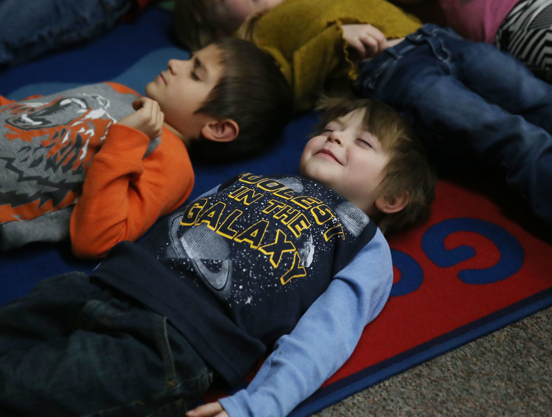 "HOLLY PELCZYNSKI - BENNINGTON BANNER Kindergartner, Conner McConnell - Secoy smiles during a mindfulness series program led by Deborah ""Deb"" Lewis where she teaches students to take deep breaths to help relax and center them."