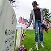 KRISTOPHER RADDER — BRATTLEBORO REFORMER<br /> Michele Miller, a freshman at St. Michael's Catholic School, in Brattleboro, Vt., puts up American flags at the gravesites of veterans at Locust Ridge Cemetery, in Brattleboro, on Monday, May 18, 2020.