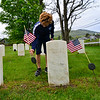 KRISTOPHER RADDER — BRATTLEBORO REFORMER<br /> Ezra Christi, a junior at St. Michael's Catholic School, in Brattleboro, Vt., puts up American flags at the gravesites of veterans at Locust Ridge Cemetery, in Brattleboro, on Monday, May 18, 2020.