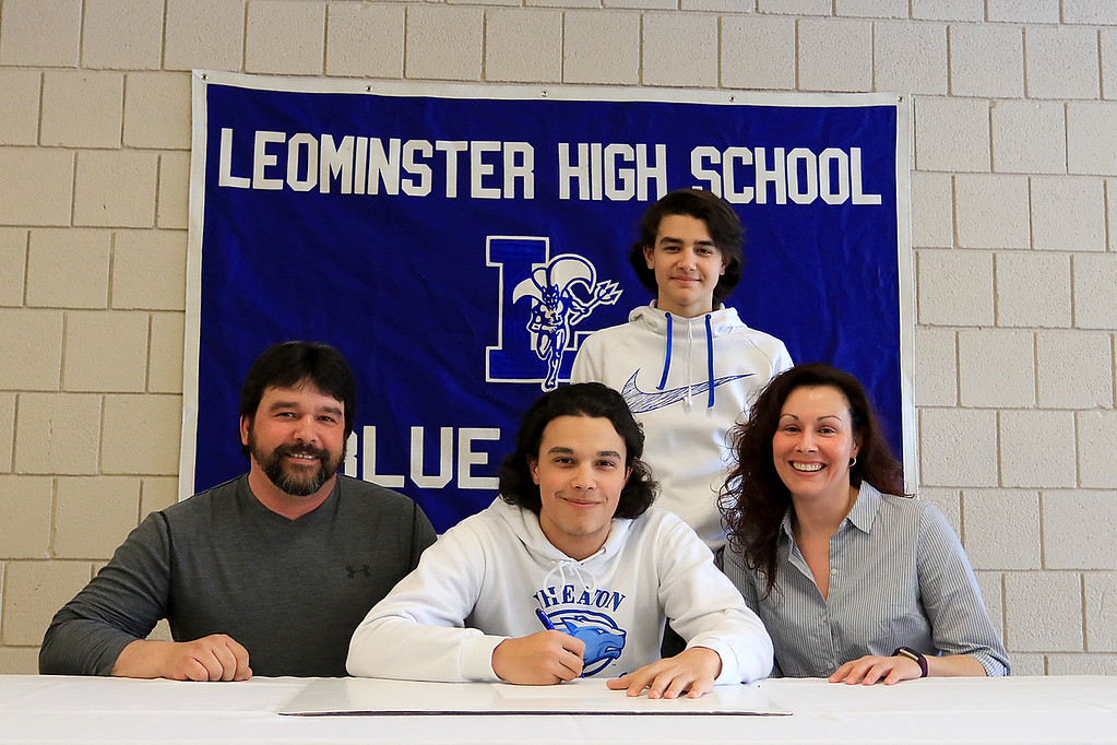 . Leominster High School held a signing day for six of it\'s student athletes that will going on to higher education and playing their prospective sports. With Dylan Sousa, who will be playing baseball at Wheaton College, is his dad Jorge Sousa, his brother freshamn Nick Sousa and mom Jennifer Sousa. SENTINEL & ENTERPRISE/JOHN LOVE