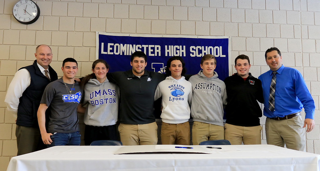 . Leominster High School held a signing day for six of it\'s student athletes that will going on to higher education and playing their prospective sports. From left is LHS Principal Dr. Steve Dubzinski, Jarrod Fournier who will be playing soccer at Central Connecticut State, Maria Spylios who will be playing soccer at UMass Boston, Zach Khallady who will be playing Football at Assumption College, dylan Sousa who wil be playing baseball at Wheaton College, Adam Couch who will be playing football at Assumption College Connor Marchand who will be playing football at Wesleyan University and LHS Athletic Director Dave Palazzi.  SENTINEL & ENTERPRISE/JOHN LOVE