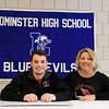 Leominster High School held a signing day for six of it's student athletes that will going on to higher education and playing their prospective sports. With Connor Marchand, who will be playing football at Wesleyan University, is his mom Kim Marchand. SENTINEL & ENTERPRISE/JOHN LOVE