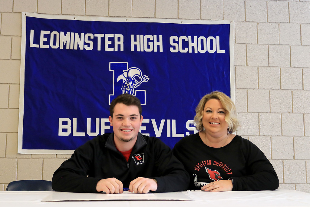 . Leominster High School held a signing day for six of it\'s student athletes that will going on to higher education and playing their prospective sports. With Connor Marchand, who will be playing football at Wesleyan University, is his mom Kim Marchand. SENTINEL & ENTERPRISE/JOHN LOVE
