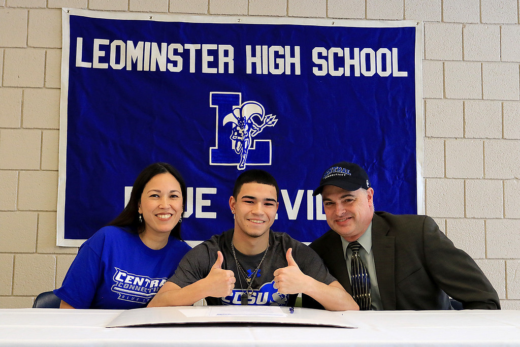 . Leominster High School held a signing day for six of it\'s student athletes that will going on to higher education and playing their prospective sports. With Jarrod Fournier, who will be playing soccer at Central Connecticut State, is his mom Candace Fournier and dad Michael Fournier. SENTINEL & ENTERPRISE/JOHN LOVE