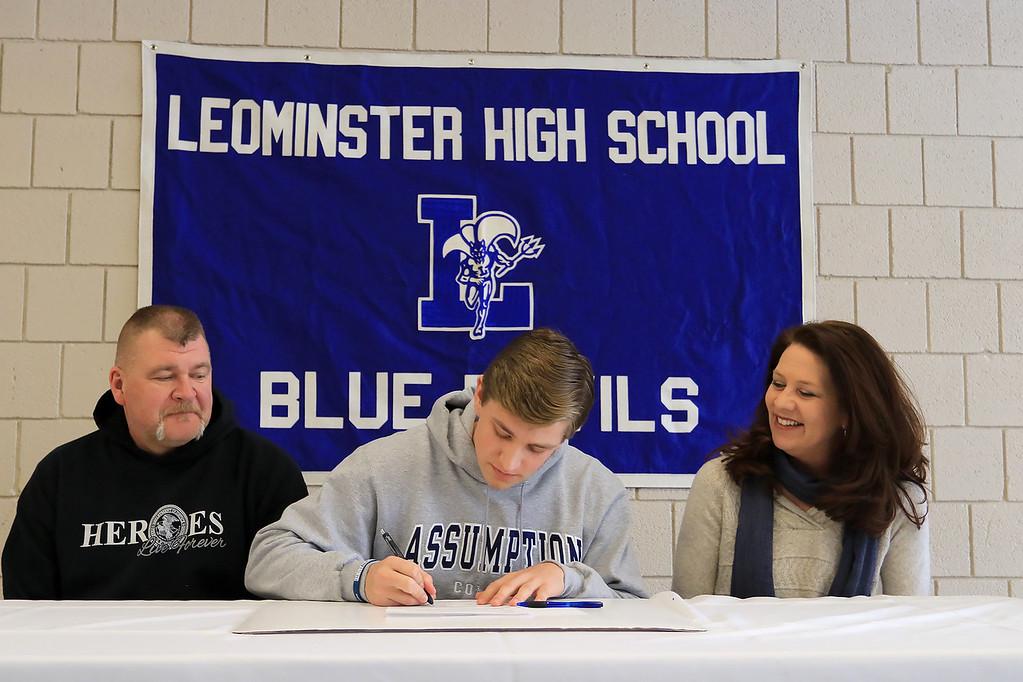 . Leominster High School held a signing day for six of it\'s student athletes that will going on to higher education and playing their prospective sports. With Adam couch, who will be playing football at Assumption College, is his dad Kenneth Couch and mom Suzan Couch. SENTINEL & ENTERPRISE/JOHN LOVE