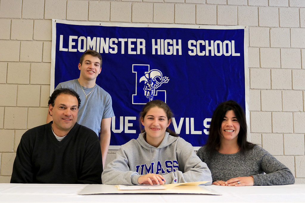 . Leominster High School held a signing day for six of it\'s student athletes that will going on to higher education and playing their prospective sports. With Maria Spylios, who will be playing soccer at UMass Boston, is her dad Timothy Spylios, brother Peter Spylios and mom Lynn Spylios.  SENTINEL & ENTERPRISE/JOHN LOVE