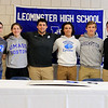 Leominster High School held a signing day for six of it's student athletes that will going on to higher education and playing their prospective sports. From left are Jarrod Fournier who will be playing soccer at Central Connecticut State, Maria Spylios who will be playing soccer at UMass Boston, Zach Khallady who will be playing Football at Assumption College, dylan Sousa who wil be playing baseball at Wheaton College, Adam Couch who will be playing football at Assumption College and Connor Marchand who will be playing football at Wesleyan University.  SENTINEL & ENTERPRISE/JOHN LOVE