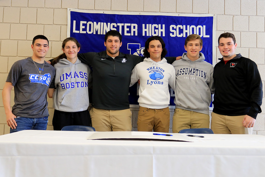 . Leominster High School held a signing day for six of it\'s student athletes that will going on to higher education and playing their prospective sports. From left are Jarrod Fournier who will be playing soccer at Central Connecticut State, Maria Spylios who will be playing soccer at UMass Boston, Zach Khallady who will be playing Football at Assumption College, dylan Sousa who wil be playing baseball at Wheaton College, Adam Couch who will be playing football at Assumption College and Connor Marchand who will be playing football at Wesleyan University.  SENTINEL & ENTERPRISE/JOHN LOVE