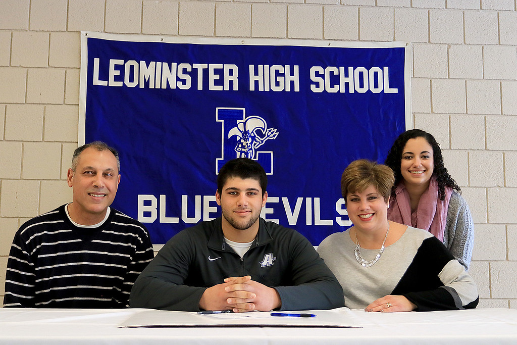 . Leominster High School held a signing day for six of it\'s student athletes that will going on to higher education and playing their prospective sports. With Zach Khallady, who will be playing football at Assumption College, is his dad Tibary Khallady, mom Judy Khallady and his sister Sarah Khallady. SENTINEL & ENTERPRISE/JOHN LOVE